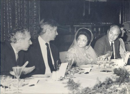 At a luncheon from left to right , are Mr. Sober, Captain Cernan, Begum Liaquat Ali Khan, and Captain Evans.