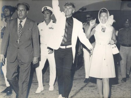 Arriving at Karachi International Airport, Captain and Mrs. Eugene Cernan wave to the welcoming crowd.