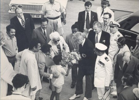 A Karachi youngster greets Captain Cernan with a bouquet of flowers at the entrance to the Quaid-i-Azam Mazar, the tomb of Mohammad Ali Jinnah, the founder of Pakistan.