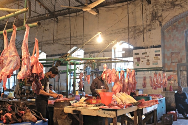 Empress Market - A Butcher cuts meat into pieces