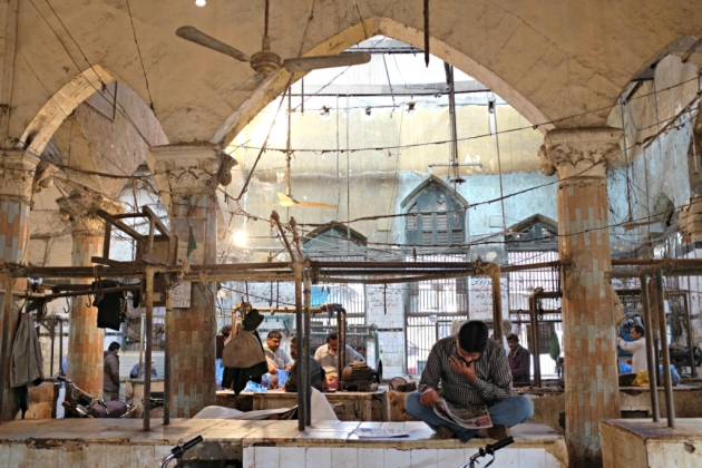 Empress Market - People start the day by reading newspaper in the meat section