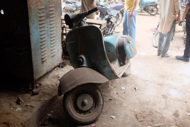 23 - A Vespa waiting in line for refurbishment