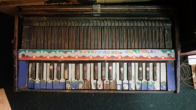 1 - A colorful harmonium waiting to go under repair at Saleem and Sons