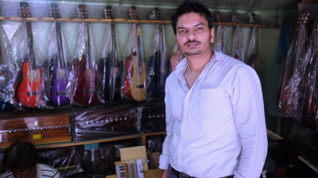 1 - Waqar poses in front of his shop