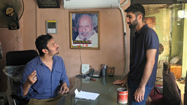 1 - Waqar speaks to a customer in his office