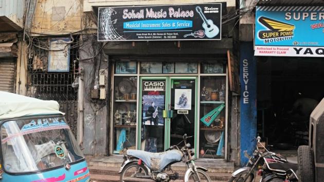 2 - Sohail Music shop has a tiny entrance tucked between mechanic shops