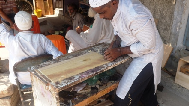 3 - A craftsman works with a piece of wood which will be used in the harmonium