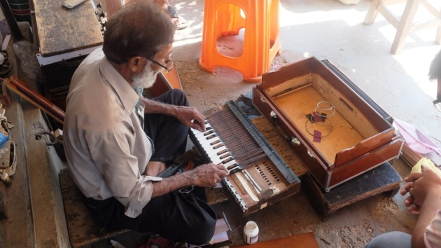 3 - Waheed repairs a harmonium in front of his shop