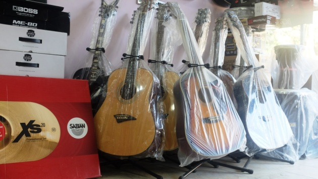 4 - Assortment of imported guitars on display