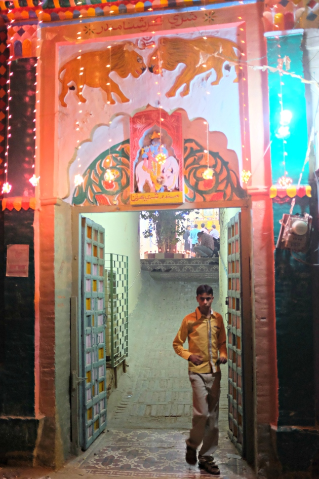 10-a-kid-passes-through-the-main-gate-of-krishna-temple