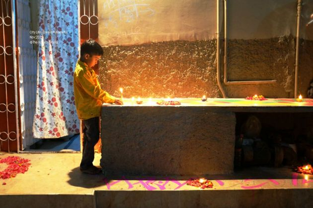 7-a-kid-lights-up-a-candle-in-front-of-his-house